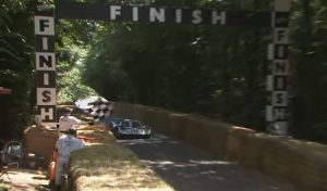 Porsche 917 flies up Goodwood hill with Derek Bell